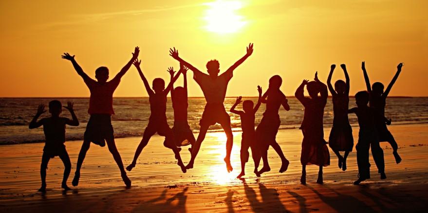 Group of people dancing on beach
